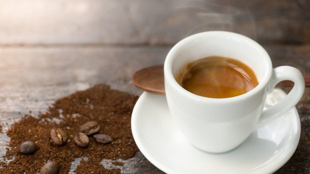 Espresso with coffee beans and grounds